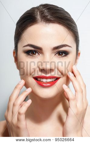 Attractive young woman is presenting her make-up