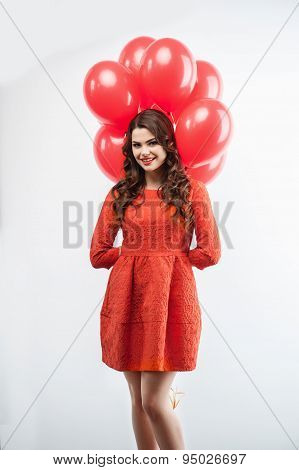 Attractive young woman with pretty smile celebrates