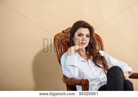 Attractive young woman is sitting in chair