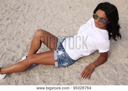 Beautiful Tanned Girl With Dark Hair In Casual Clothes