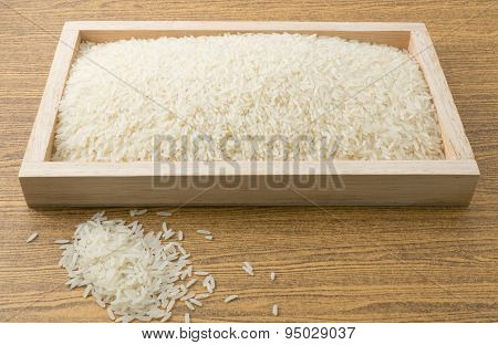 Uncooked Jasmine Rice In A Wooden Tray