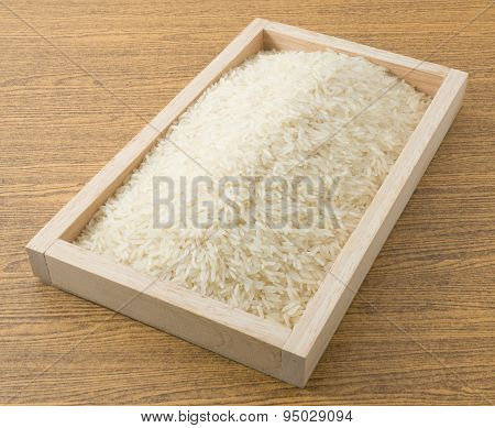 Thai Jasmine Rice In A Wooden Tray
