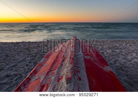 Baltic Sea Shore And Boat After Sunset