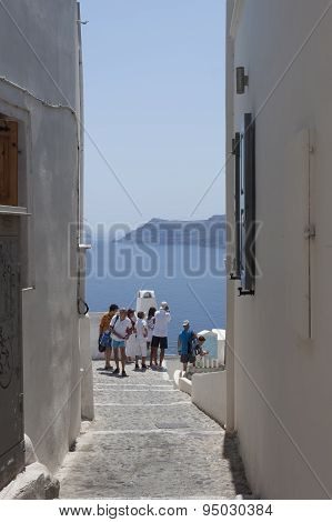 People In The Narrow Streets Of Santorini