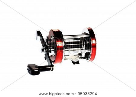 Multiplier Fishing Reel On White.