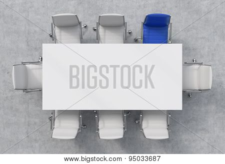 Top View Of A Conference Room. A White Rectangular Table And Eight Chairs Around, One Of Them Is Blu