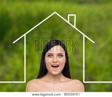 Portrait Of An Astonished Brunette Girl. Drawn Silhouette Of The New Home On The Green Background.