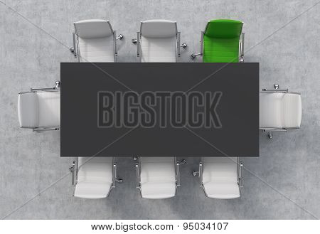 Top View Of A Conference Room. A Black Rectangular Table And Eight Chairs Around, One Of Them Is Gre
