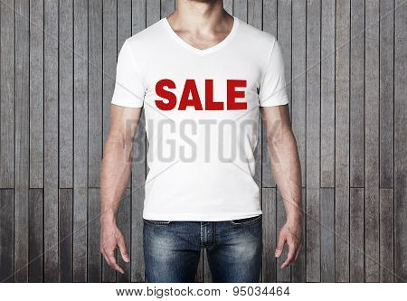 Close Up Of The Body View Of The Man In A White T-shirt With The Red Word ' Sale ' On The Chest. Ver
