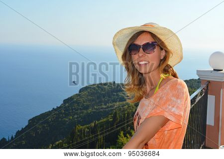 Young Girl With Straw Hat Looking At The Seaside From Extraordinary Golden Fox Viewpoint At Corfu Is