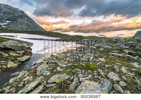 High Altitude Alpine Lake And Cloudscape At Sunset