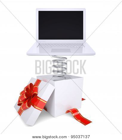 Gift box with red band and laptop