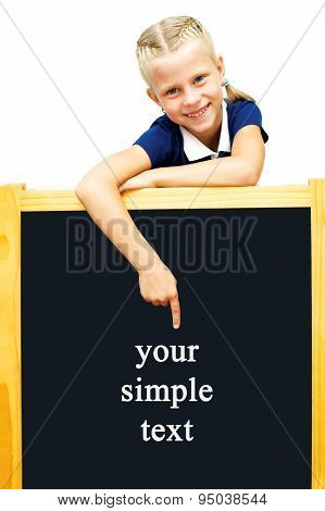 Cute Schoolgirl Points To A Blackboard. Advertising. Isolated On White Background.