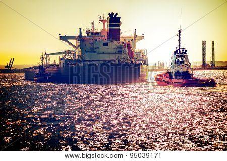 Ship On Sea At Sunset
