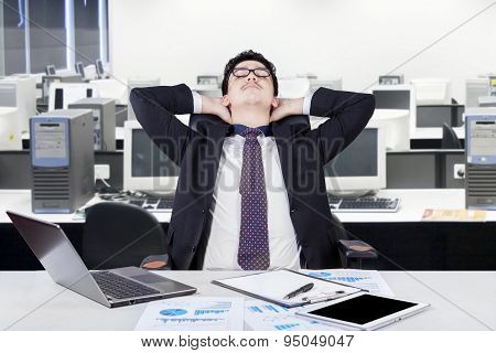 Male Worker Relaxing In The Workplace