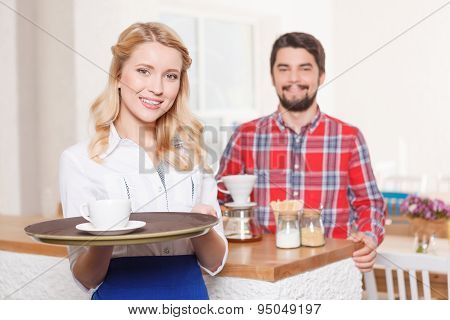 Waitress with tray on background of customer