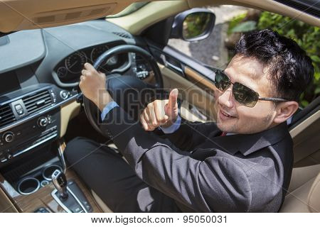 Successful Man Shows Thumb Up In New Car