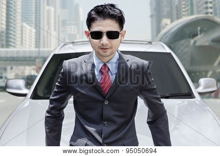 Young Man With New Car On The Road