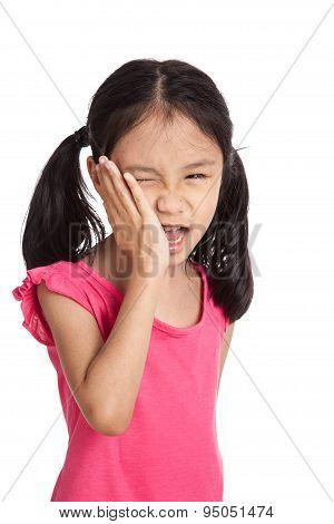 Little Asian Girl  Got Toothache Put Her Hand To Cheek