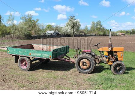 Old Tractor With Trailer In The Village