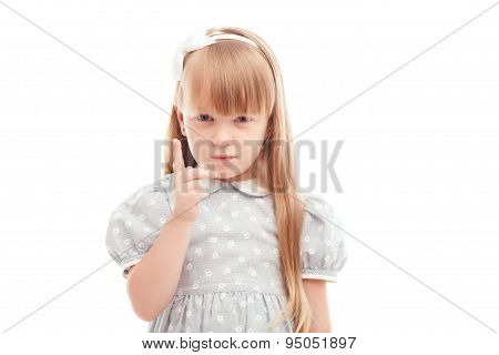 Nice little girl holding finger in front of face