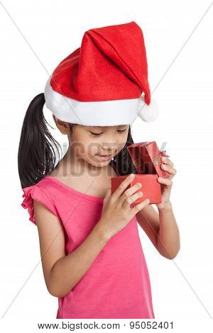 Happy Little Asian Girl With Santa Hat And Gift Box