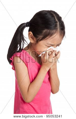 Little Asian Girl Sneeze With Napkin Paper