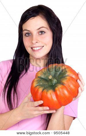 Brunette Girl With A Big Pumpkin