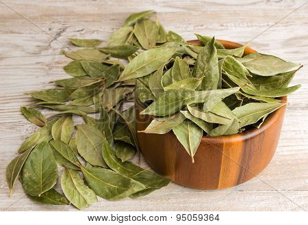 Dry Bay Leaves And Wooden Bowl