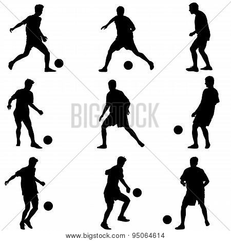 Different Poses Silhouettes Of Soccer Players With The Ball. Vec