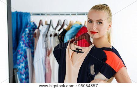 Beautiful Blonde Woman Trying New Dress