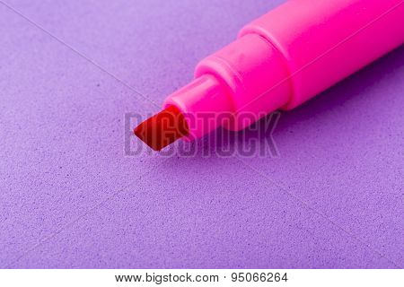 Pink marker on purple background