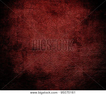 Grunge background of barn red leather texture