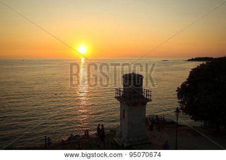 Tourists Watching Sunset On Adriatic Coast