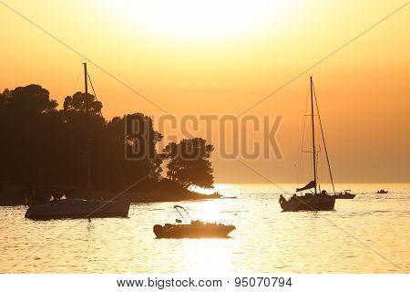 Boats Anchored At Sunset