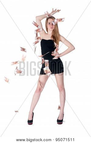 Beautiful young lady among flying cash