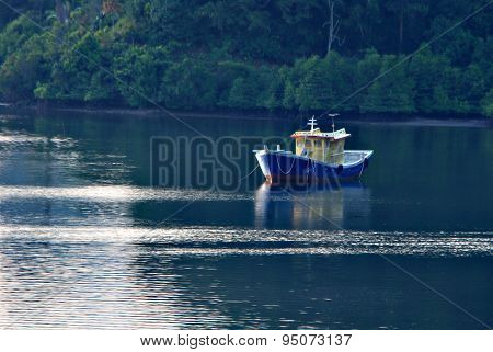 Fisherman Boat Docked By The Shore Of Mengkabong Cove, Tuaran, Sabah, Malaysia On An Erly Morning.
