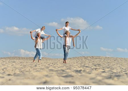 Boys with grandparents on sand