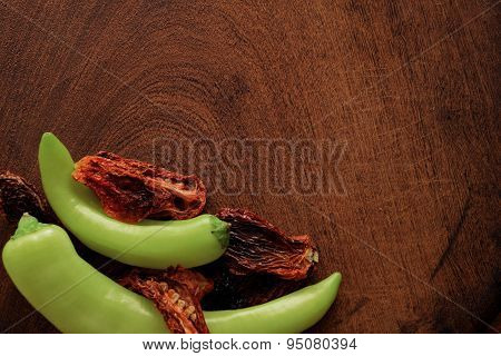 Sun Dried Tomatoes, Green Peppers On A Cutting Board