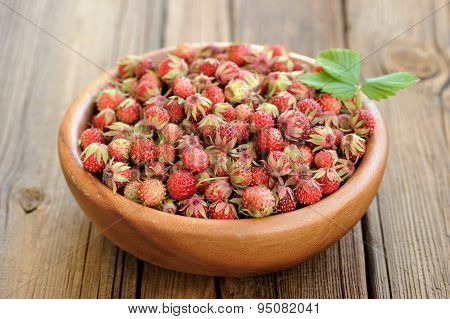 Wild Strawberries Fragaria Viridis With Green Leaf In Wooden Bowl