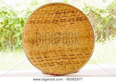Basketwork contains earthenware steamer and threshing basket.