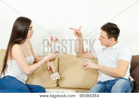 Young Adult Couple Fight Over Stupid Card Game