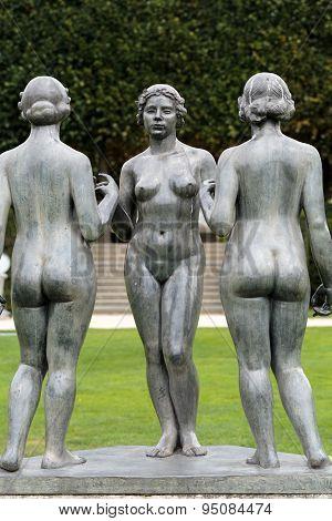 PARIS, FRANCE - SEPTEMBER 11, 2014: Paris - Bronze sculpture The Three Nymphs by Aristide Maillol in Tuileries garden