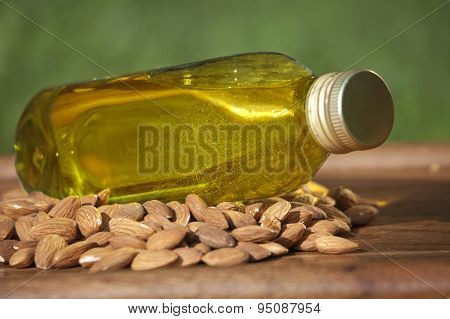 Almond Oil In A Bottle And Almonds Nuts