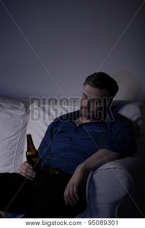 Man Falling Asleep With Bottle