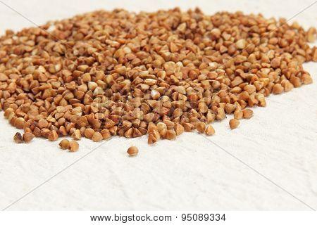 Buckwheat On A Rough White Fabric Background.