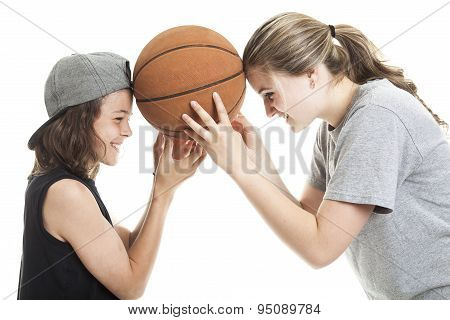 Portrait of brother and sister with a basket ball