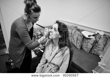 Young Brunette Bride Applying Wedding Make-up By Make-up Artist