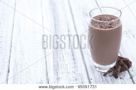 Chocolate Milk (on Wooden Background)