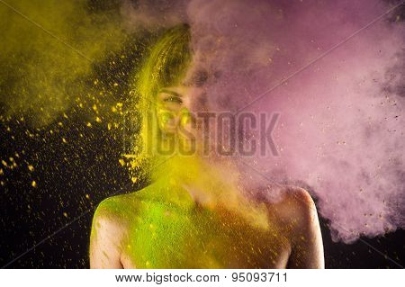 attractive girl in Holi colors on a black